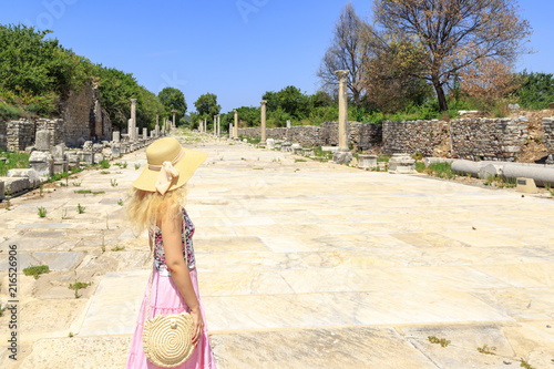 Fotografering  Young adult blonde looking at port route in Ephesus, Izmir, Turkey