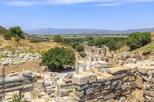 Valokuva  Ephesus, Izmir, Turkey - July 8, 2018 : People are walking through ancient stree