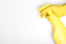 Hand Yellow Glove And Yellow Bottle Sprayer