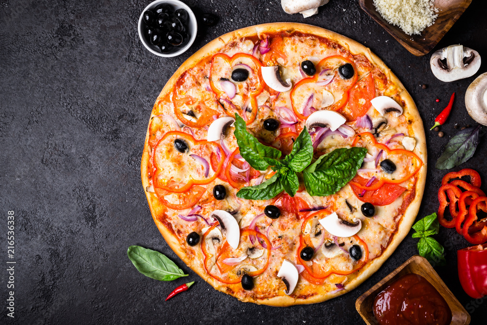 Vegetarian pizza with mushrooms and olives on black background