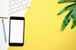canvas print picture - Blank screen smartphone and keyboard with note pad placed on yellow background. Suitable for graphics used for advertising.