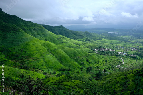 Poster Blauwe hemel Lush green monsoon nature landscape mountains, hills, Purandar, Pune, Maharashtra, India