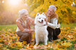 canvas print picture portrait of beautiful caucasian senior couple with dog