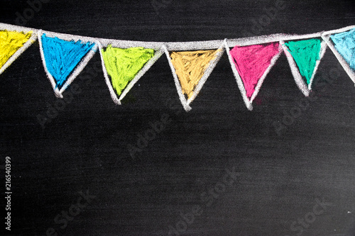 Colorful chalk drawing in hanging party flag shape on blackboard background Canvas Print