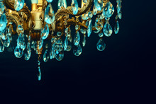 Crystal Chandelier Close-up. Dark Background