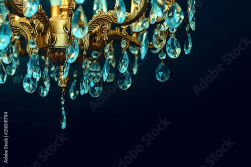 Cuadros en Lienzo Crystal chandelier close-up. Dark background