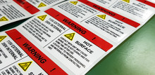 """Danger Sign Banner With Warning Text,""""HOT SURFACE"""" Warning Label In Electronic Industry"""