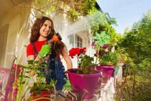 Happy Girl Watering Plants On Terrace Garden
