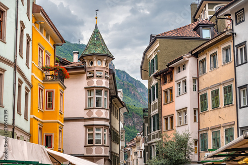 Fotografie, Obraz  Colorful historic buildings in the city center of Bolzano with high mountains in