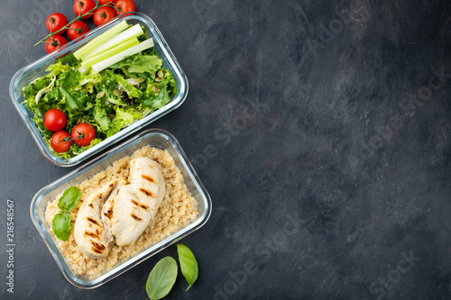 Foto op Canvas Kruidenierswinkel Healthy meal prep containers with quinoa, chicken breast and green salad overhead shot with copy space. Top view. Flat lay