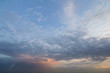 Panorama of sky at sunrise or sunset. Beautiful view of dark blue clouds lit by bright orange yellow sun on clear sky. Beauty and power of nature, meteorology and climate changing concept.