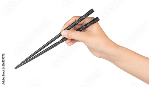hand holding wood black of chopsticks isolated on a white background Canvas Print
