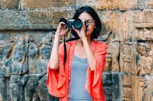 Asian Female Solo Travelers And Take Photo Ancient Buildings- Borobudur Temple- Java -Indonesia- Asia.