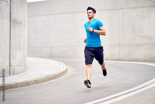 Poster Jogging Fitness and sport concept. Athletic man during jogging session in the city