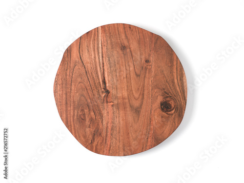 Round wooden tray or cutting board isolated on white background. Top view of empty kitchen trendy rustic wooden tray saw cut imitation. Isolated on white with clipping path. Copy space for text.