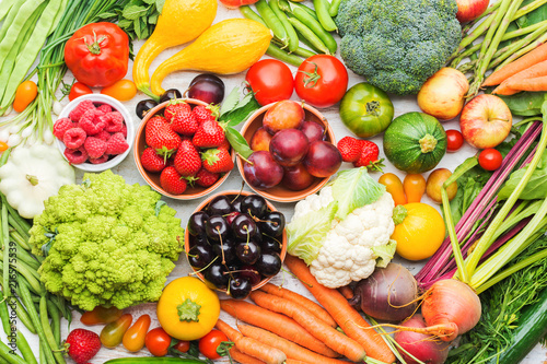Tuinposter Keuken Summer fruits vegetables berries background, apples cherries peaches strawberries cabbage broccoli cauliflower squash tomatoes carrots spring onions beetroot, top view, selective focus