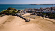 Aerial Drone View Of Boats Beached At Low Tide At The Beautiful Welsh Holiday Resort Of Tenby