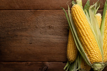 Fresh Corn On Cobs On Rustic W...