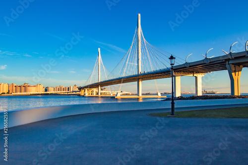 Canvas Prints Bridge Bridge. Highway. Embankment on the background of the bridge. Highway against the blue sky.