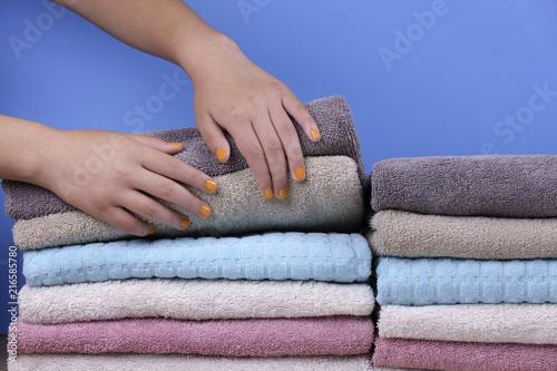 Fotografie, Obraz  Lifting up stack of towels.