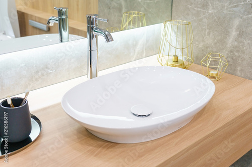 Cuadros en Lienzo Interior of bathroom with sink basin faucet and mirror