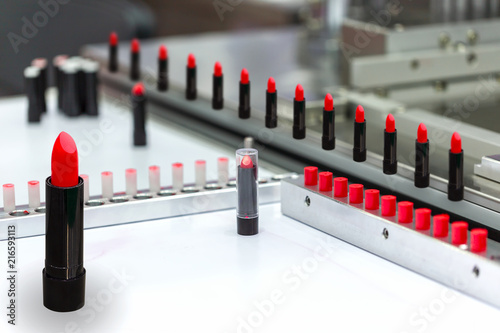 Fototapeta A lipstick vial filling machine in a cosmetics factory. obraz