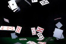 Flying Poker Cards On Black Background. Casino Concept.