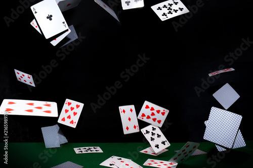 Cuadros en Lienzo Flying poker cards on black background. Casino concept.