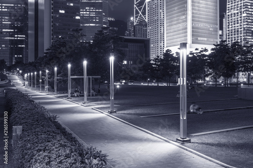 Promenade and skyline of Central district in Hong Kong city at night Poster