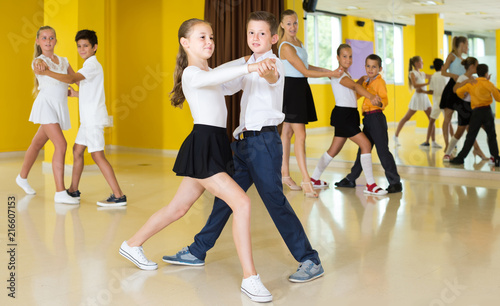 Children  dancing pair dance in class