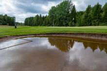Bunker Full Of Water On A Golf Course