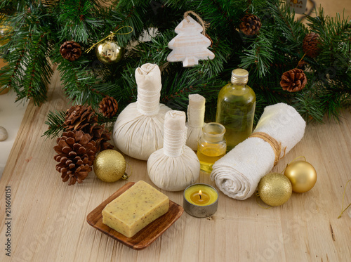 Spa treatment with Christmas decorations-mat and wooden background