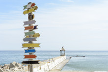 Multiple Blank Signs On A Wooden Pole In The Beach.place For Text.