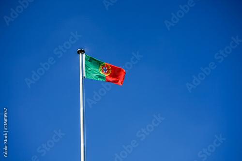 фотография  portugal national flag and blue sky