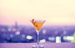 canvas print picture - Orange cocktail at a rooftop