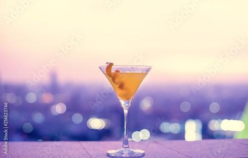 Fotografie, Obraz  Orange cocktail at a rooftop