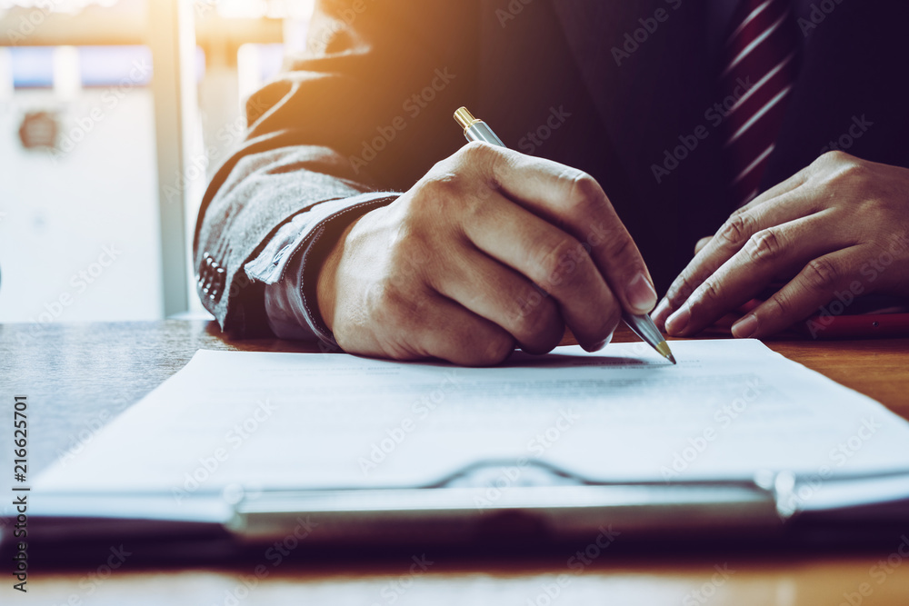 Fototapeta Business man sign a contract investment professional document agreement.