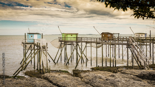 Row of fishing huts on elevated wooden stilts Fototapeta