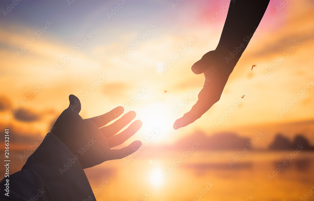 Fototapeta The concept of God's salvation:silhouette of helping hand concept and international day of peace