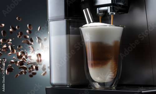 Canvas Prints Cafe Coffee machine with flying coffee beans across it on dark background. Concept studio shooting. High speed freezing photo