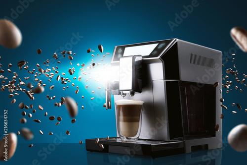 Fotografie, Obraz  Coffee machine with flying coffee beans across it on dark background