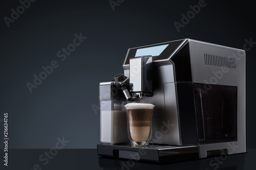 Door stickers Cafe Coffee machine without flying coffee beans across it on dark background. Concept studio shooting. High speed freezing photo