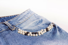 A Pocket On Jeans Decorated With Pearly Beads. Beads Of White And Black Color. Denim.