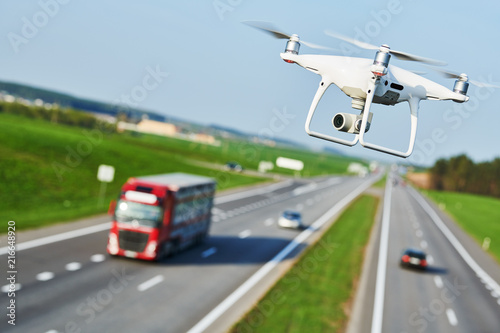 drone and transportation  drone with camera controls highway road