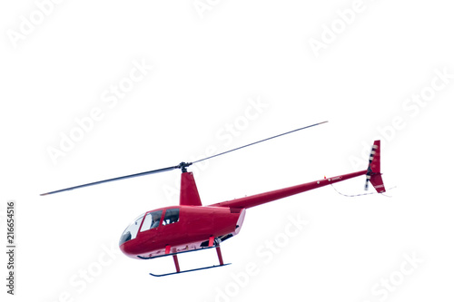 Freigestellter roter Hubschrauber auf weißem Hintergrund