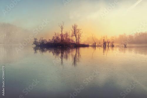 Fototapeta Island and mysterious fog over river obraz