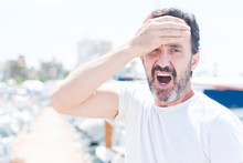 Handsome Middle Age Man In Marina Stressed With Hand On Head, Shocked With Shame And Surprise Face, Angry And Frustrated. Fear And Upset For Mistake.