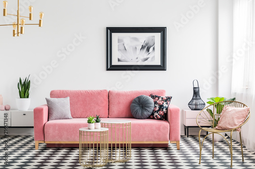 Fotografie, Obraz  Glamour living room interior with a pink sofa, golden armchair and tables, painting and checkered tiles