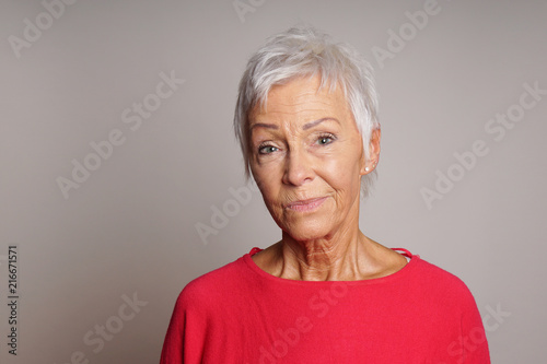 Fotografie, Obraz  mature woman in her sixties with a skeptical look on her face