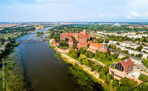 Fotobehang Europa Malbork Castle on the bank of the Nogat River. UNESCO world heritage in Poland